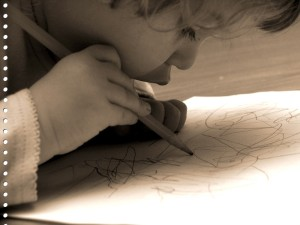 Routine versus Schedule: little girl drawing on paper.