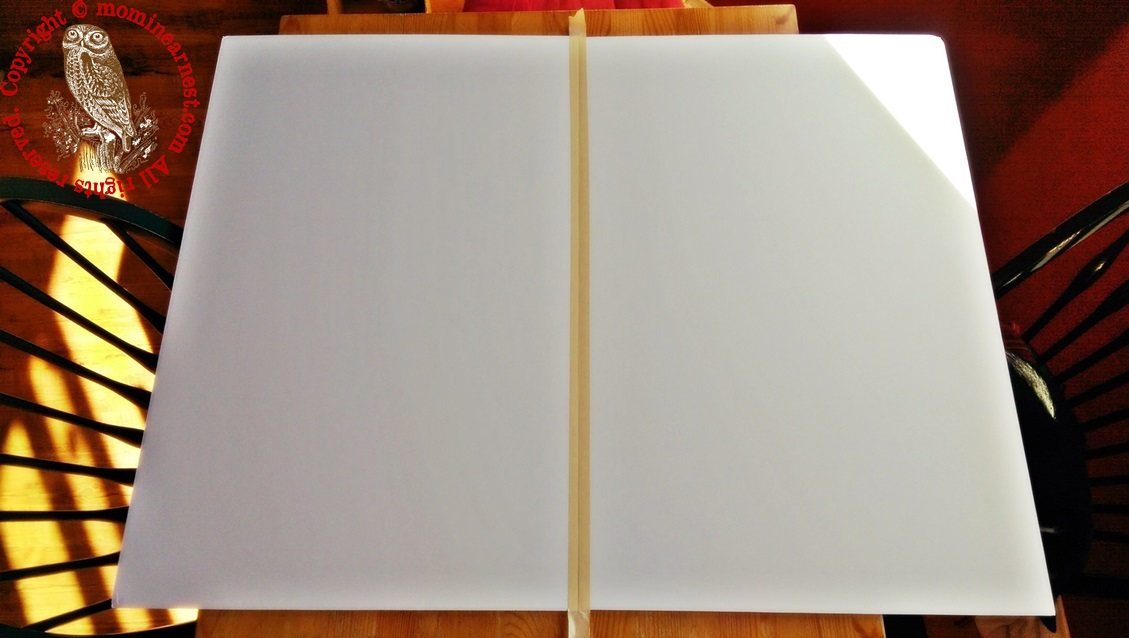 two blank foam boards taped together