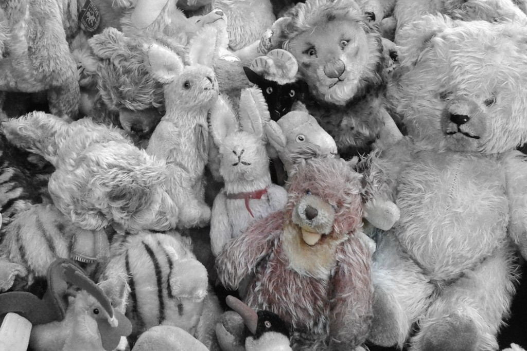 stop buying everything your kids see: teddy bear nestled among friends.